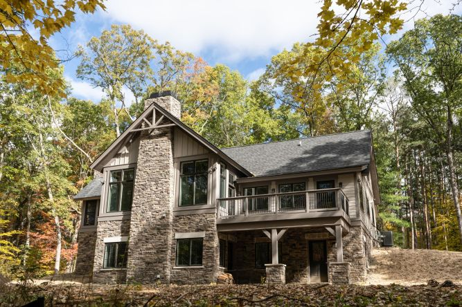 Rustic cabin with stone foundation