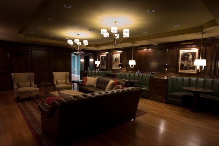 Tiered ceiling above dark wood paneled ballroom