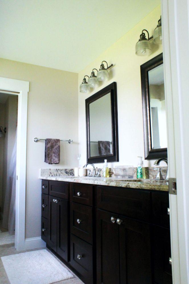 Dark wood cabinet with granite counter