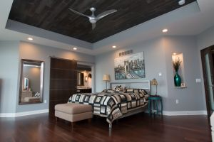 Brushed chrome contemporary bed frame with recessed wood plank ceiling above
