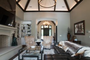 Furniture set for a Hunting Lodge adorn a grand living room with large limestone fireplace