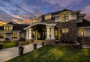 Twilight view of custom home designed by McCotter Architecture and Design