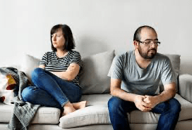 distant couple in need of couples therapy in Rockville, MD. They work with a couples therapist from montgomery county counseling center for marriage counseling in Maryland online therapy.