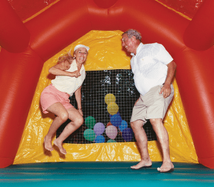 adults playing in a bounce house