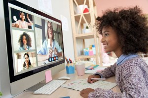 African American teen girl meets with her online DBT skills group in Virginia where she works with a DBT therapist to learn emotional regulation and DBT skills.