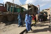Afghan women walk towards a damaged house following an earthquake, in Kabul, Afghanistan, Monday, Oct. 26, 2015. In Afghanistan's Takhar province, west of Badakhshan, at least 12 students at a girls' school were killed in a stampede as they tried to get out of the shaking buildings, a local official says. Sonatullah Taimor, the spokesman for the Takhar provincial governor, says another 30 girls have been taken to the hospital in the provincial capital of Taluqan. (AP Photo/Rahmat Gul)