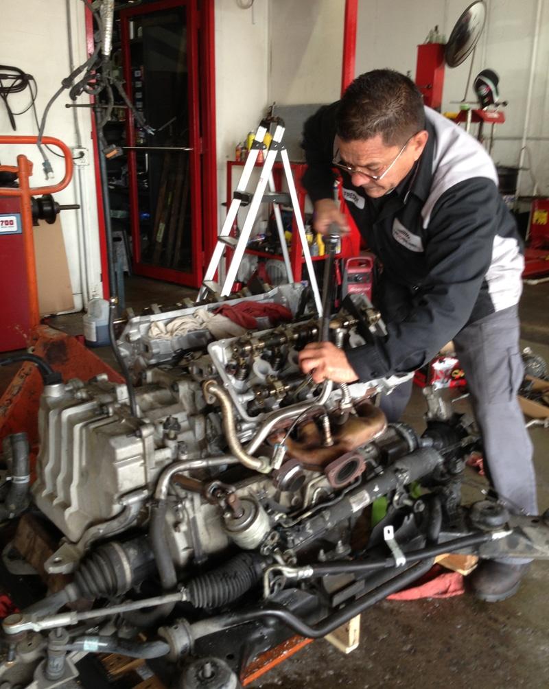 medium resolution of tech working on engine