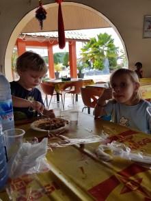 Enjoying their waakye and jollof rice