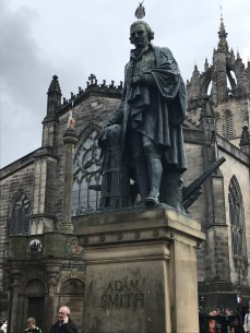 Adam Smith with a little political comment on top.