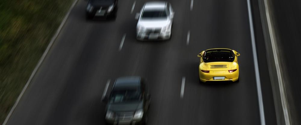 A car is shown driving on the interstate in the wrong direction. An auto accident attorney will make sure the driver and insurance company pay.