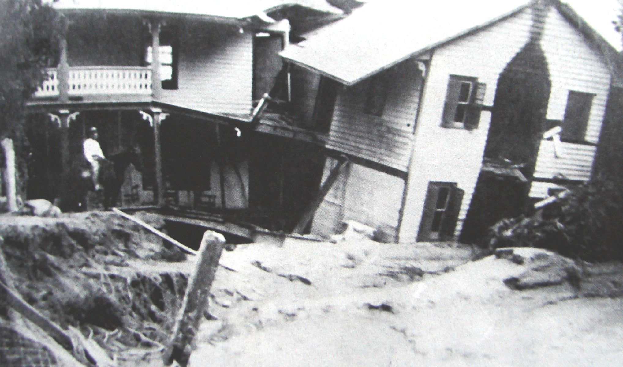 One of the many homes to be ruined by the flood. Countless others totally washed away, leaving hardly a trace that they had ever stood at all. (Photo from the Carson House Library)