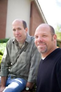 two men smiling at camera