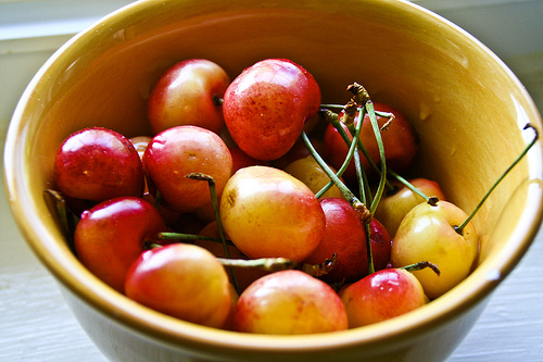 Rainier cherries nestled in a ceramic bowl