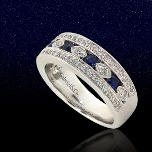white gold band with round sapphires and diamond side stones