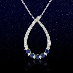 white gold teardrop shaped pendant with 5 round sapphires and diamond side stones