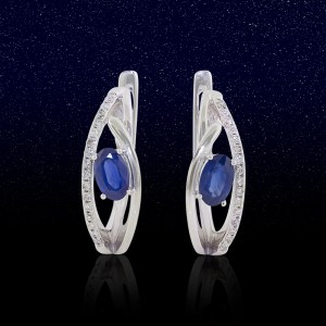 white gold hoop earrings with oval sapphires and diamond side stones