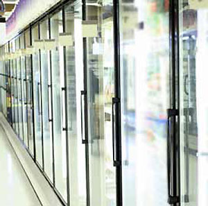 Electrically conductive specialty glass can be used to keep glass panels clear in retail settings where commercial refrigeration is used.
