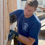 Boy Scout, nearing Eagle, organizes scoring booth build