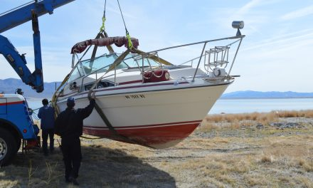 Abandoned boat proves difficult to move