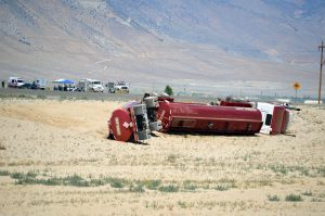 On June 29, a semi-truck truck carrying gasoline and diesel overturned at the U.S. Highway 95 bypass, closing the road for some 18