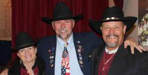 Lodge 1704 Exalted Ruler Steve McBride, center, greets outgoing Elk State President Lee Butts and his wife Ruth at the Nevada State Elks covention last weekend in Hawthorne.