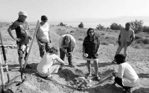 Sheri Samson Participants and the instructors uncover their Raku efforts from the cooled down sandy pit Sunday morning.