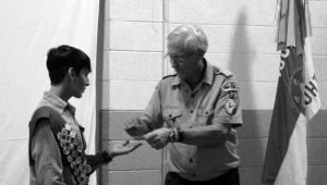 Sheri Samson Diego Pittman receives his Silver Badge from Scout Master Jim Pruss at the Troop 75 Court of Honor.