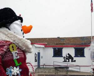 Sheri Samson Noel the snowman stands outside of Jerry's Barber Shop on E Street in Hawthorne.