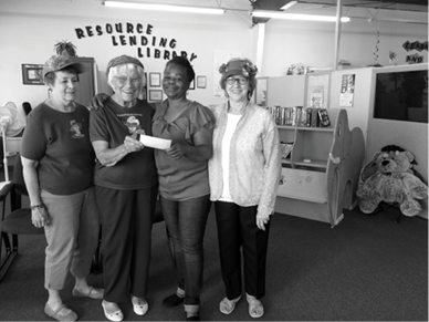 Courtesy photo -  The Mad Hatters presented a $200 check to CAHS to buy needed school supplies.