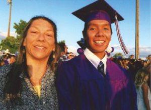 Dalton Broncho with mentor Katherine Quartz at his high school graduation in Yerington.