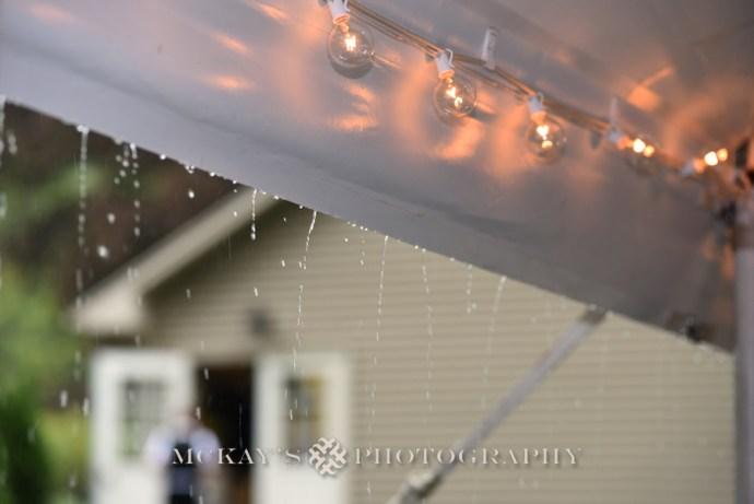 rainy backyard wedding with tent