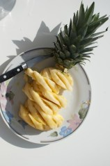 cutting pineapple by a pair & a spare