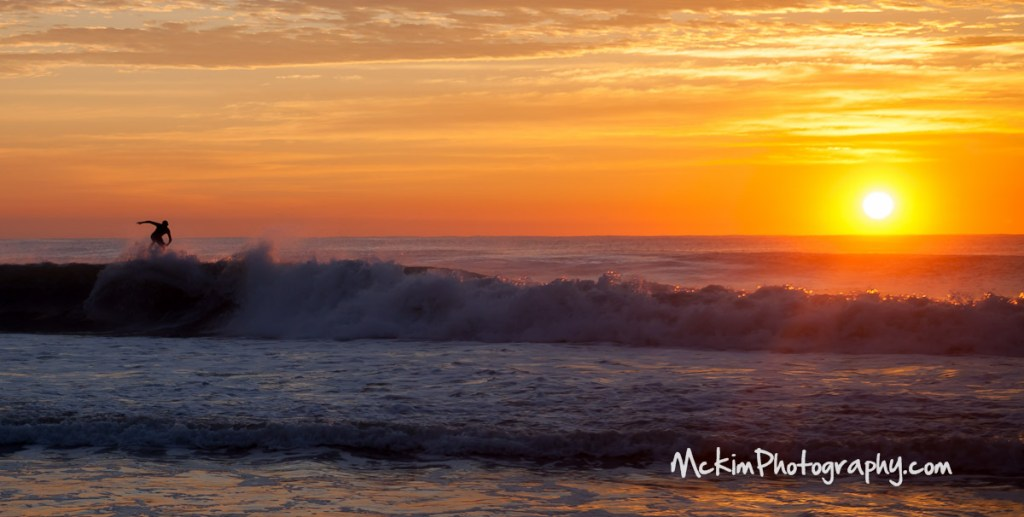 Surfers at Sunrise Belmar Beach NJ