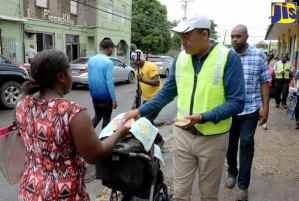 PHOTOS: Min. Tufton Distributes Dengue Brochures