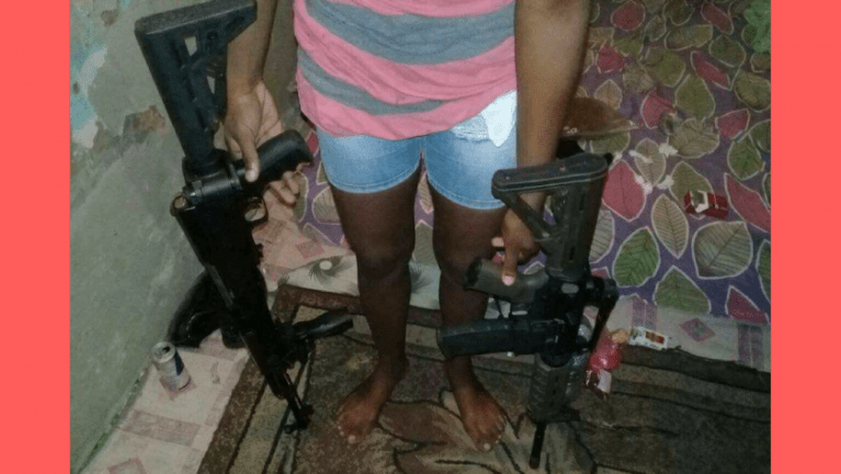Young Woman Sporting Assault Rifles