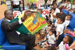 Education Minister Hon. Ruel Reid Reads to Kids