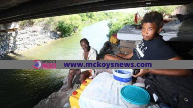 Man with three women lives under bridge