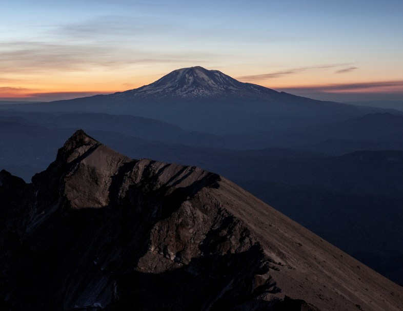 Sunrise behind Mt. Adams from the moonlit summit of Mount St. Helens.