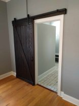 Barn doors are great space savers and they look super cool!