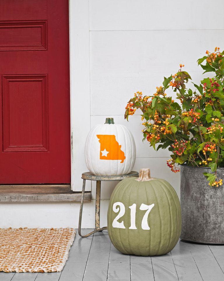 paint decorations on pumpkins