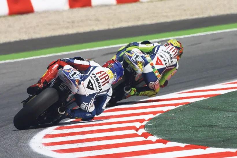 Rossi battles with teammate Jorge Lorenzo