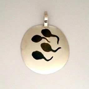 Tadpole Pendant: Inlaid silver.