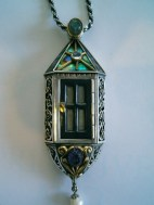 The Door: Pendant, Gold, Silver, shakudo, lapis lazuli, shell, various stones