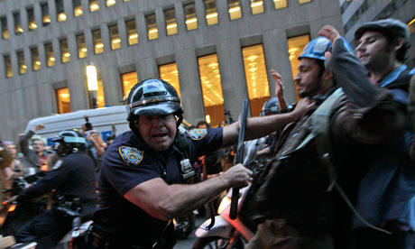 A-police-officer-shoves-a-007