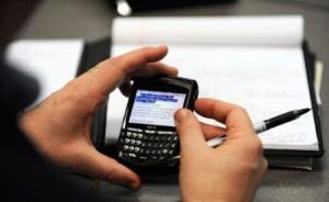 man-using-blackberry-e1300240170203