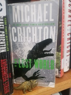 toy triceratops near book Lost World by Michael Crichton
