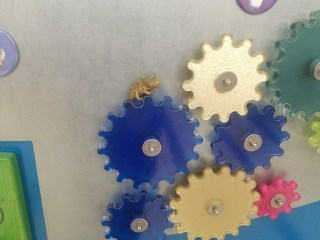 toy triceratops on plastic, magnetic gears