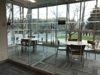 Tables and Chairs in the New Glassed-In Collaboration Spaces