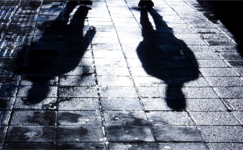 Two shadows on a dark street