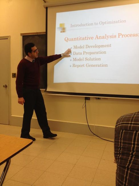 Professor Amir Masoumi teaching his Operations and Quality Management class. Photo by Sean McIntyre.